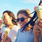 Women eating ice cream on a beach