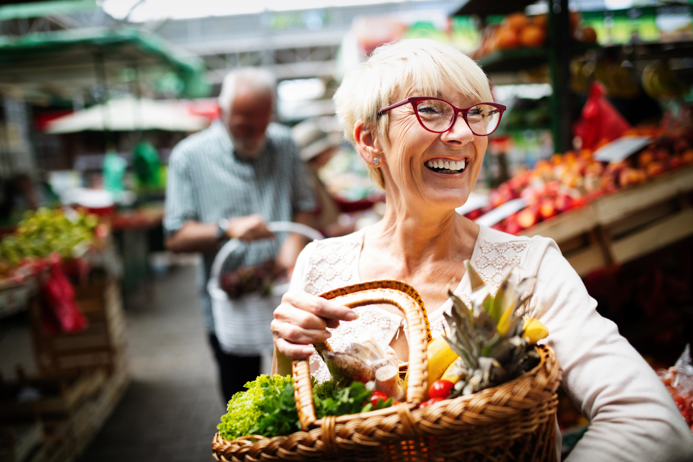 Mature woman buying vegetables at farmers market-flipped