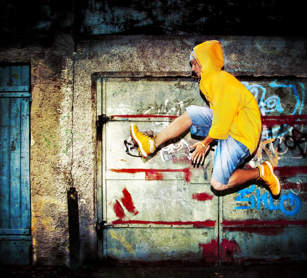 A man dancing in an urban setting